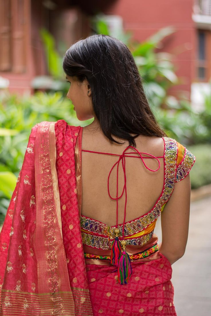A detail rich stunner! Carefully crafted in a chevron patterned raw silk, with vivid border detailed with a striking red piping. What can we say…this blouse is sure to turn heads.   Pick any color in the blouse for a saree pairing and be the stand out diva!