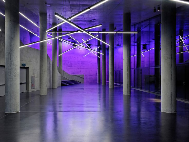 Small Olympic Hall, Munich, 2011     Lichtlauf developed and delivered 210 running meters of free suspended linear light elements in high-gloss stainless steel cases, with integrated safety lighting.     Architecture: Auer+Weber+Assoziierte, Munich  Lighting design: pfarré lighting design, Munich  Photography: Andreas J. Focke, Munich