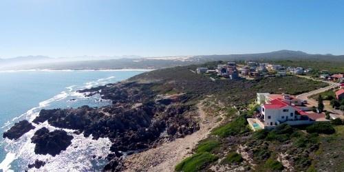 Aerial photo of Cliff Lodge and the De Kelders coastline www.clifflodge.co.za