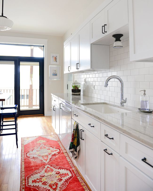 Our kitchen renovation took 8 months to complete with plenty of road bumps along the way #realtalk, but man, it was worth it. We are loving this classic and timeless bright white space! // via Yellow Brick Home