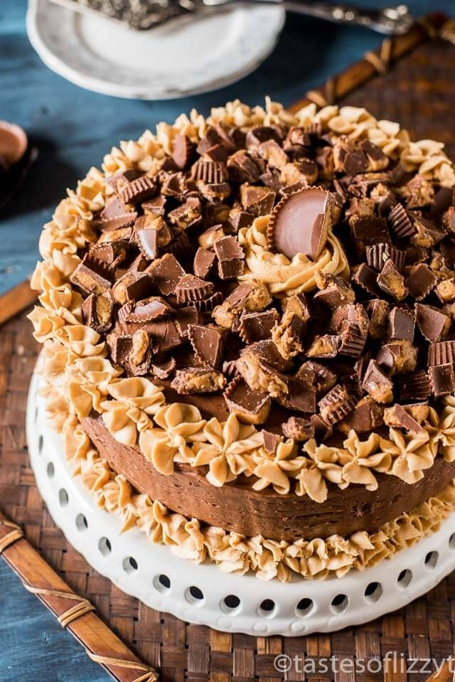 Chocolate Peanut Butter Reese's Cake is a moist, from scratch chocolate cake with peanut butter frosting and chocolate buttercream frosting.