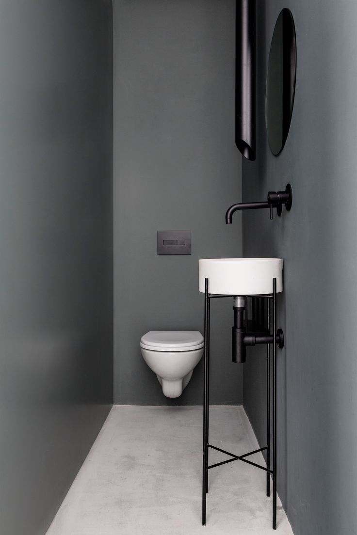 Apartment bathroom ideas - Sculptural Metal Elements Stand Out In Minimalist Tel Aviv Apartment Bathroom Greysmall