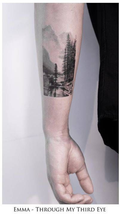 Black and grey landscape tattoo on Daryl's left forearm. Tattoo artist: Emma Bundonis