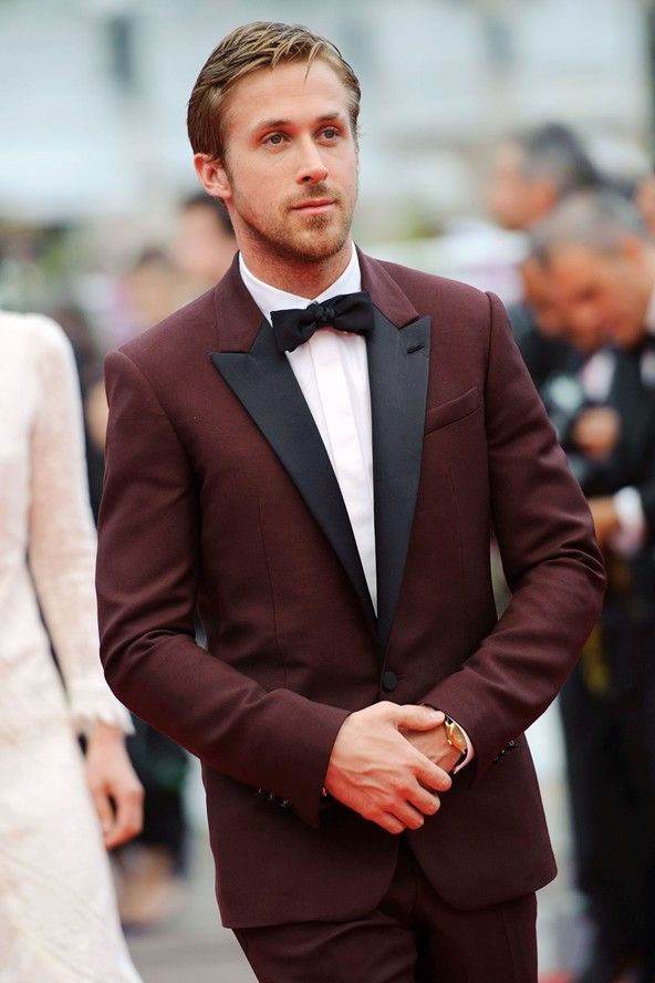 Ryan Gosling shows the red carpet how to rock red with restraint: tone it down a bit and wear a  burgundy tux.