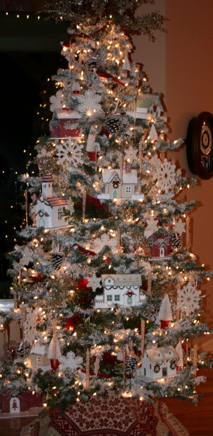 Moore Minutes: A Christmas Village in the Tree and other Tree Traditions    I sprayed my tree this year too with snow. It looks similar to this!!!!  Awesome