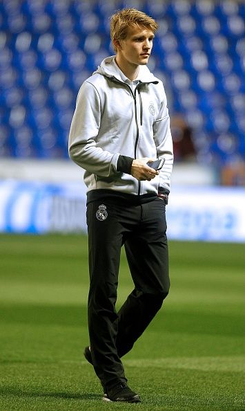 Real Madrid's Norwegian midfielder Martin Odegaard walks on the pitch before the Spanish league football match Levante UD vs Real Madrid CF at the...