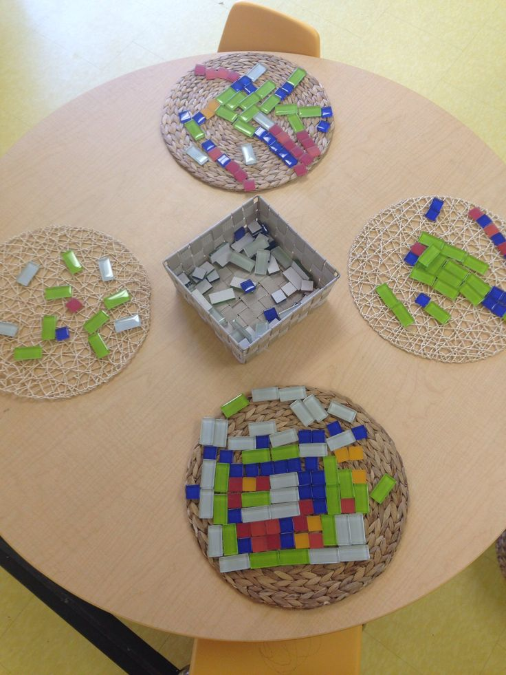 Creating patterns, shapes, and pictures using glass tiles-The Sunflower School Orangeville Ontario