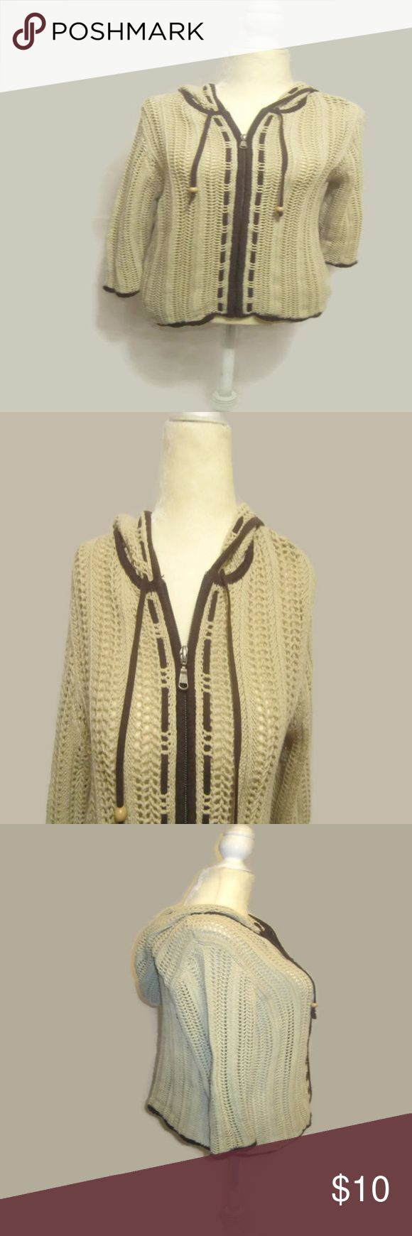 "Eddie Bauer Open Weave Hooded Cardigan Nice Open Weave Hoodie Zip Up Cardigan from Eddie Bauer  Full Zip Up  Nice Neutral Beige with Brown Trim - Perfect Color to Pair with All of Your Favorites  Wooden Beads Tie Ends   Hood  Open Weave Crochet  Women's Size Medium Measure Armpit to Armpit 19"" Length from Shoulder to Hem 24""  EXCELLENT Pre-Owned Condition  Smoke Free Environment Eddie Bauer Sweaters Cardigans"