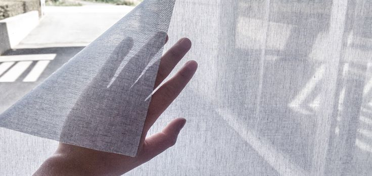 Squid is a self-adhesive transparent fabric for covering windows which allows you to see out, but stops people outside from looking in during the day.