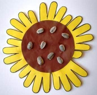 Sunflower Handprints - This would be cute to  make a bunch of these for a bulletin board adding a stem and leaves.