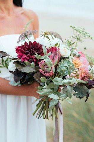 Hand tied bridal #bouquet with ribbons | Sarah Falugo Photography | see more on: http://burnettsboards.com/2014/04/unique-beach-wedding-inspiration-shoot/