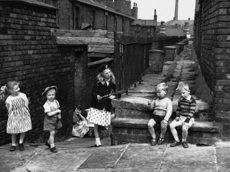 © Shirley Baker  Children Playing in a Back Alley - Salford, Manchester 1962