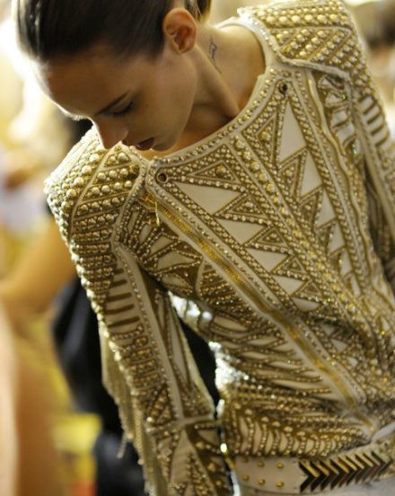 "The ""exoticness"" of the pattern and shoulders is epic with the luxe beading"