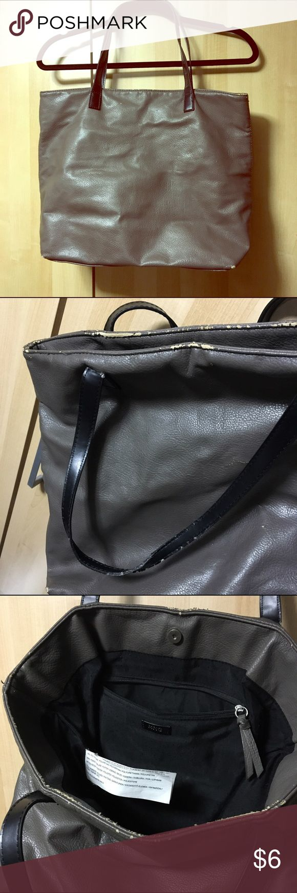 MNG Used Tote MNG Mango roomy gray colored tote with black handles. Magnetic closure, one main compartment with small zippered compartment inside. Pre loved bag with major signs of usage edges and corners of the bag and handles, please refer to photos. Questions welcomed. Mango Bags Totes