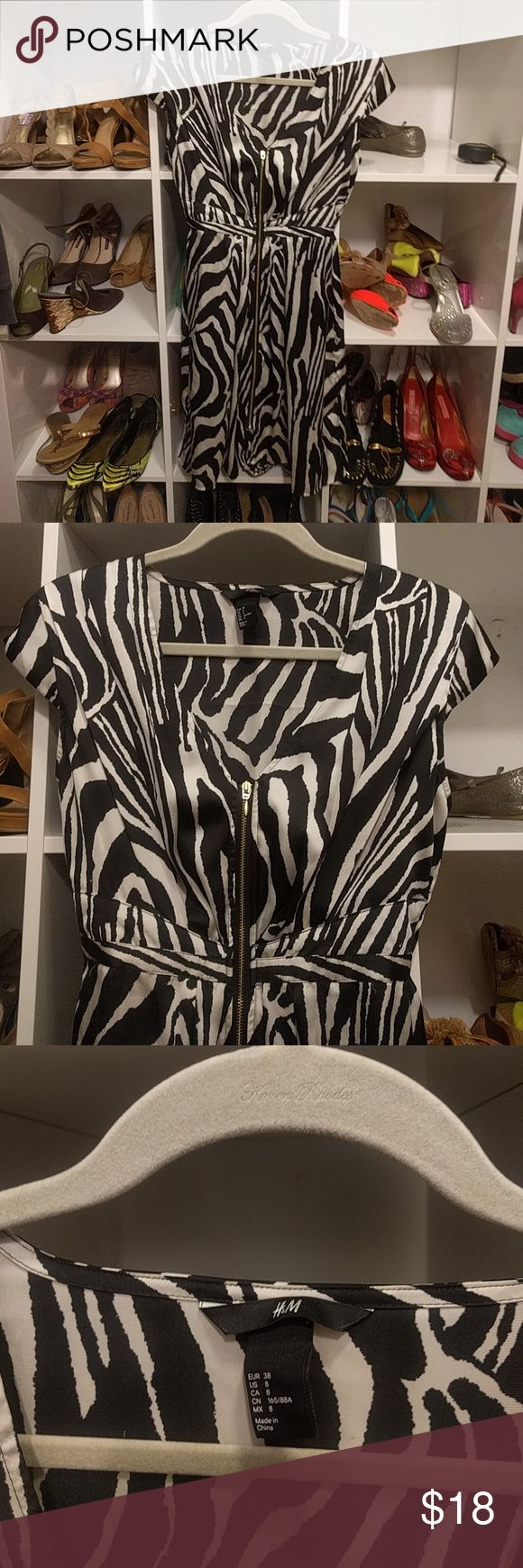 H&M SILKY ZEBRA zippered dress. Great waist line! This super chic zippered dress is light flowy silky and gives a fantastic waist line! Cap sleeve. Easy to wear. Doesn't wrinkle! Great for travel and cruise ships! 32.5 long H&M Dresses Mini