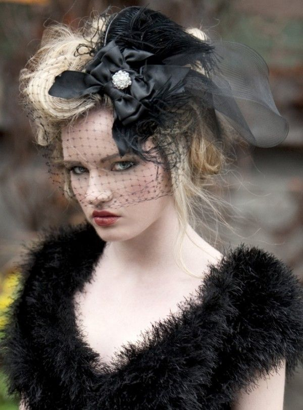Complete your non-traditional wedding look with this all black bird cage veil.