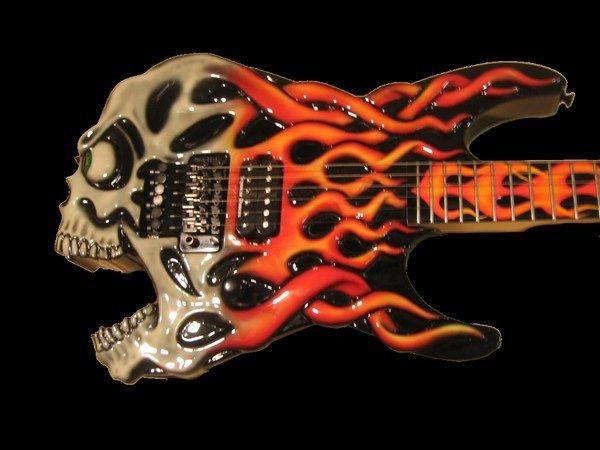 Google Image Result for http://www.synergyguitars.com/ESP-Guitars/ESP-Guitar-Images/ESP-Screaming-Skull-Guitar-Jimmy-Diresta-1-Black.jpg