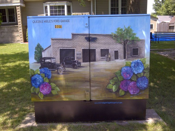 "a telephone utility box I painted in Essex, ON.  Had to be historical - ""Queen & Wigle's Ford Garage"""