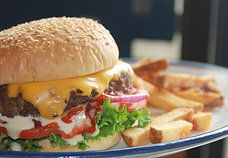 Famous Specialty In - House 1/2 lb. (8oz) Patty with Lettuce, Tomatoes, Onions, Ketchup and homemade mayo.