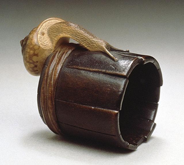 Shigemasa (Japan, Tokyo, 1739 - 1820)   Snail on Well Bucket, early 19th century  Netsuke, Wood with staining