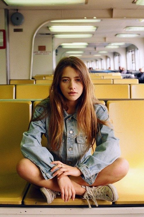 She liked to sit in empty trains, know every station off by heart and never get off, just go back to the start. Wondering, sulking some days, and looking at people trying to guess their stories and look out of the window escaping into an other world existing in her head.