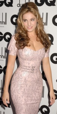 Kelly Brook; this dress fits her like a glove, I must know who designed this.