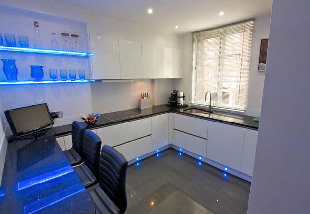 A Contemporary Handleless White Gloss Kitchen Is Energised With Blue Led Shelf And Plinth