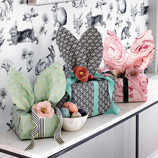 Easter gifts wrapped in pretty paper with playful bunny ears make an enchanting display, while rabbit-patterned wallpaper is a whimsical touch all year round. Homes & Gardens. http://www.hglivingbeautifully.com/2016/03/18/seasonal-style-easy-ways-to-decorate-your-home-for-easter-celebrations/