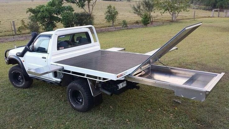 custom flatbed with slide out storage trays.