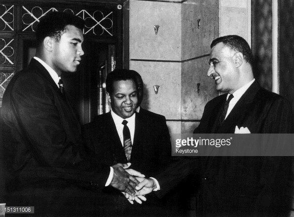 Heavyweight boxer Muhammad Ali shakes hands with Egyptian President Gamal Abdel Nasser watched by Ali's manager Jabir Herbert Muhammad circa 1964...
