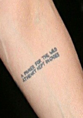 """Another Angelina Tat.  It's a Tenessee William's quote that reads:  """"A prayer for the wild heart kept in cages."""""""