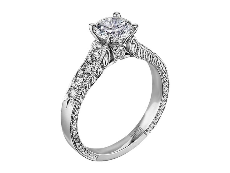 Collection: RadianceStyle #: M1126R310 Description: Ladies 14k White Diamond Engraved Mounting with .40ctwDia Weight: 0.40ct Available Metal: 14kt, 18kt, Platinum, Palladium Setting: Classic Diamond Beautiful vintage style with solitaire look. Available at CMI Jewelry Showroom in Raleigh NC
