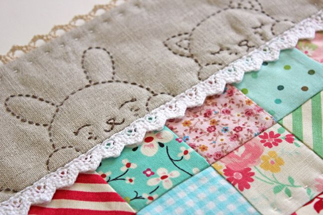 This cute baby quilt is created using a variety of patterned cotton fabric squares, complimentary solid top border and lacy edging. Description from freequiltpatternsonline.com. I searched for this on bing.com/images