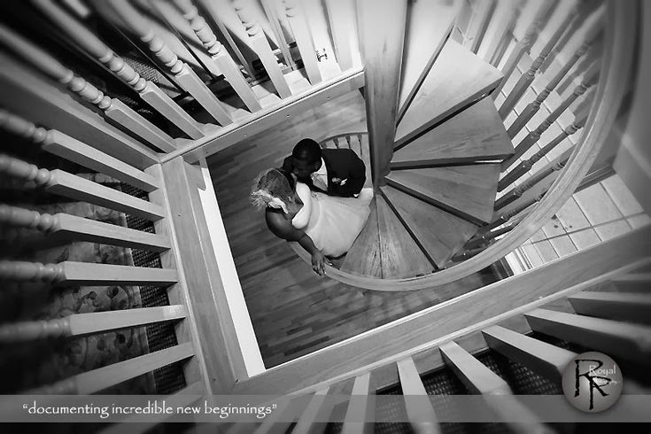 Bride & Groom at the bottom of our spiral staircase. Royal Photography at the Hawthorne House Wedding Venue