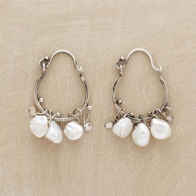 """Winter/Spring Earrings  Like winter flurries or a freefall of springtime petals, natural Keshi pearls and paillettes are set aflutter on Naomi Herndon's handcrafted sterling silver hoops. Ours exclusively with snap down wires. 1-1/4""""L."""