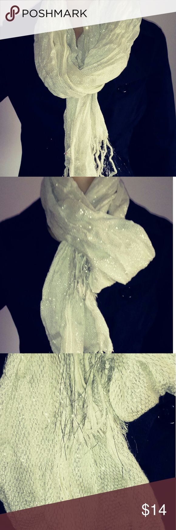 Sparkle Scarf All that glitters isn't gold.... Linen scarf with silver accents all throughout Lightweight but useful and super cute! Good for dressing up the cold weather.. Accessories Scarves & Wraps