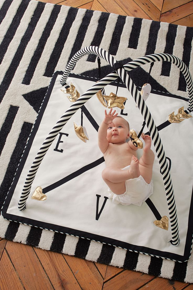 A first look at the new Emily + Meritt Pottery Barn Kids nursery collection! The designers were inspired by their favorite childhood stories when dreaming up this whimsical wonderland. The collection is vintage charm with a modern twist, filled with black and white plush toys, soft pink and gold bedding, and brass animals straight from a dream.