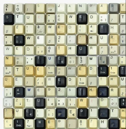 Typographic wall calendar by Harald Geisler recycling old keyboards via PAGE online