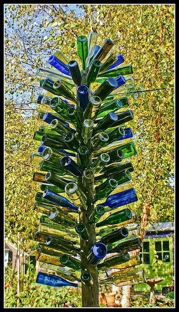 Wine Bottle tree. Yes! I want mine to look like this. Not like those puny ones. And with frosted wine bottles!