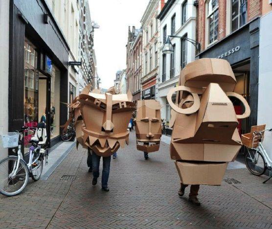 cardboard puppet heads parade