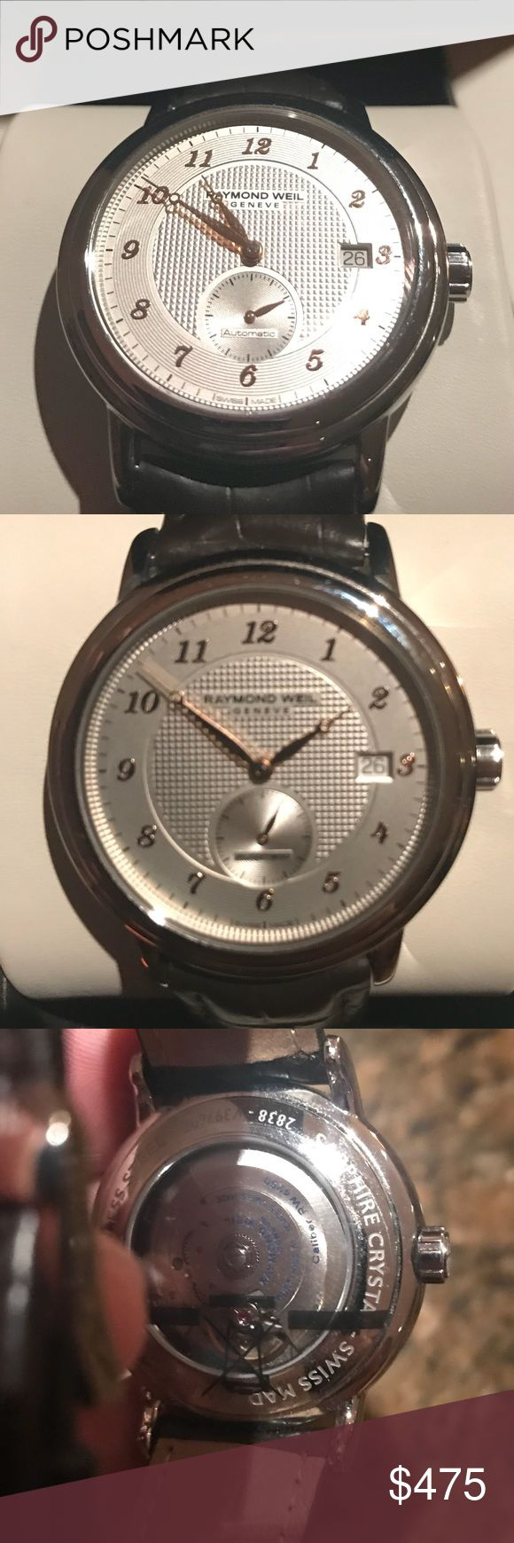 Men's Raymond Weil wristwatch Raymond Weil Geneve stainless steel housing copper hands and a black leather band. Raymond Weil Accessories Watches