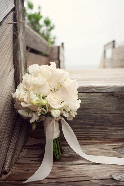 White bouquet maybe with mint green ribbon instead.