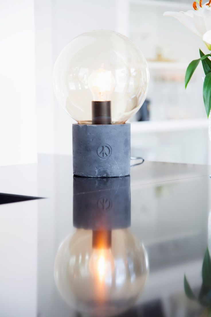 Concrete table lamp Peacebubble with a clear glass shade deisgned by Åsa Gassle. Click the image and check other colors.    #sessakdesign #sessaklighting #sessak #lighting #sisustus #valaisin #new #newin #pöytävalaisin #interior #inredning #interior #Vintage #Modern #Minimalistic #Nature