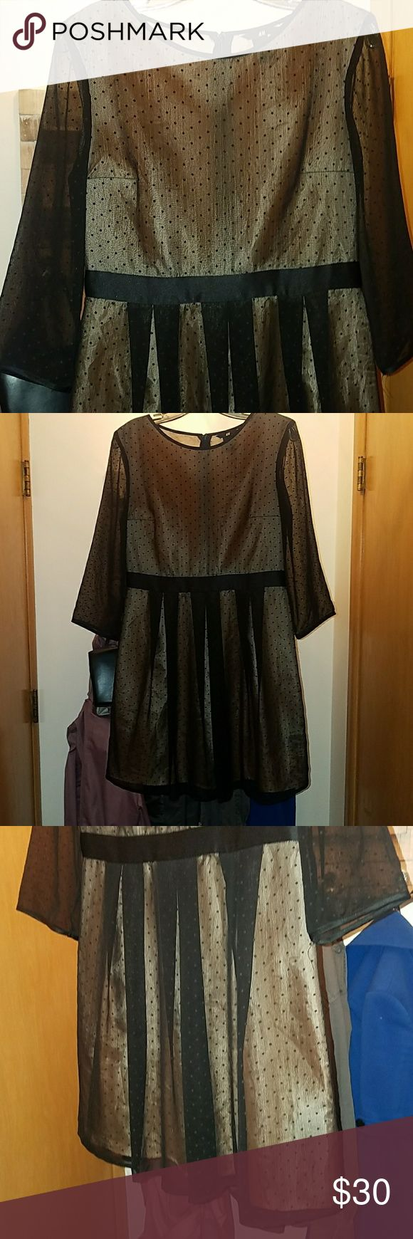 H&M Polka Dot Mini Dress Adorable little dress! Goldy slip underneath with sheer black polka dot overlay. Sleeves are completely sheer as seen in pic. Super cute party dress! Great condition! 100% polyester H&M Dresses Mini