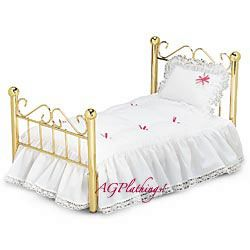 Samantha's Bed  Samantha sleeps in a shiny brass-plated bed. It's a four-poster with a curvy Victorian headboard. Her soft white mattress is covered with a lace-trimmed spread tufted with pink ribbons. Her fluffy pillow is edged in ruffles, lace, and ribbons, too. In a bed so beautiful, how could she have anything but pleasant dreams? Z
