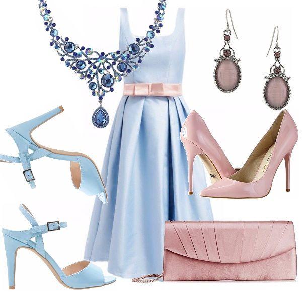 """Delizioso l'abito azzurro pastello, con fiocco in vita rosa scollo tondo, gonna a campana. L'ho abbinato ad un sandalo azzurro, ed a una décolleté rosa. Pochette in raso rosa. Collana """"importante"""" con pietre dure, orecchini rosa."""