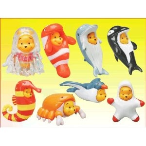 Disney Collections - Peek-a-Pooh Ocean Figures #7 Set Of 8 Gacha Figures by TYC USA. This TYC Gachapon figure size is about 1 inch tall and includes Crab Pooh, Clownfish Pooh, Starfish Pooh, Jellyfish Pooh, Seahorse Pooh, Dolphin Pooh, Whale Pooh, Seagull Pooh