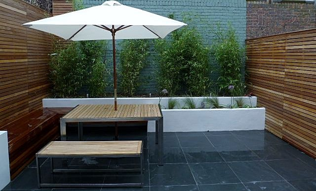 I like this idea of raised plant beds that could contain ferns of other shade loving plants.