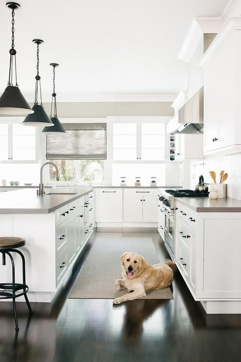 ebony wood floors in a white kitchen balances a classic