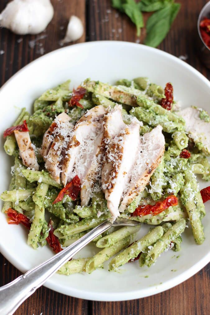 Creamy Pesto Pasta with Chicken & Sun Dried Tomatoes - a quick and easy 30 minute recipe with a creamy pesto sauce, chicken, sun dried tomatoes & parmesan. Gluten free. | passmesometasty.com